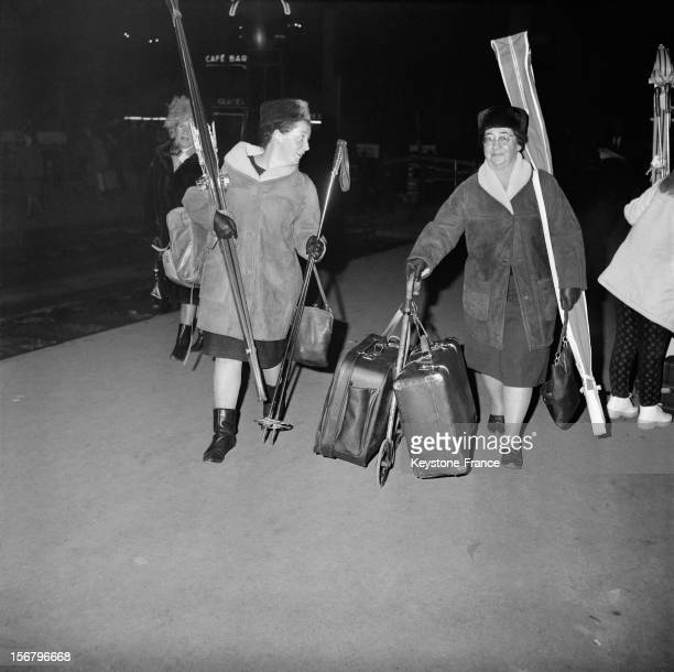Families depart for the ski resorts by train at the Gare de Lyon station three days before Christmas on December 22 1963 in Paris France