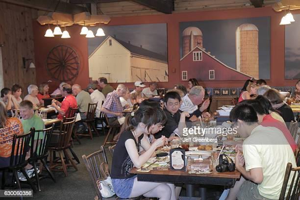 Families eating at Plain Fancy Farm Restaurant
