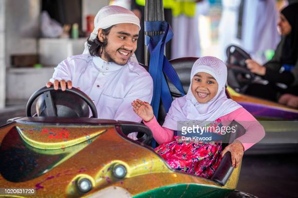 Families enjoy rides on the dodgems during an Eid in the Park celebration marking Eid AlAdha at the New River Sports ground in Wood Green on August...