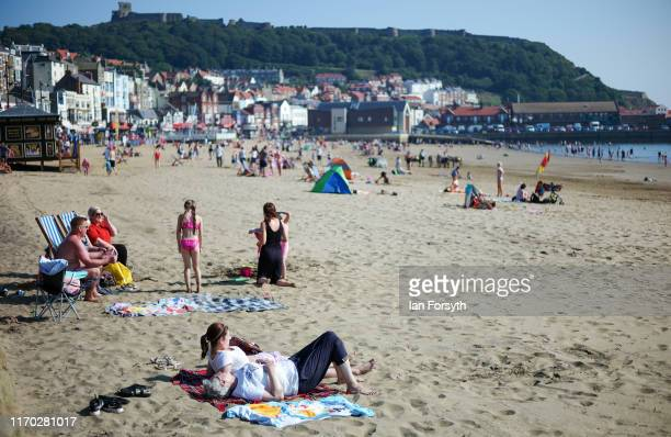 Families enjoy Scarborough beach on Bank Holiday Monday on August 26 2019 in Scarborough United Kingdom Temperatures have climbed over 30C in parts...