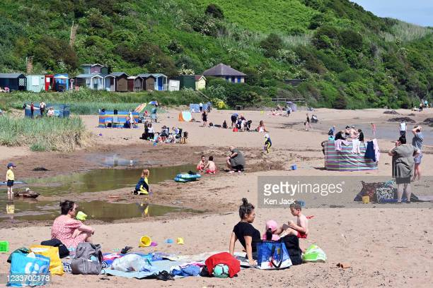 Families enjoy the sunshine on the beach at Coldingham Sands, as much of Scotland enjoys fine weather at the start of the school holidays, on June 28...