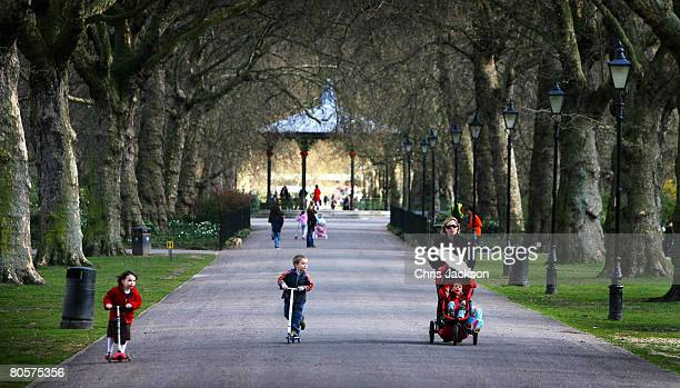 Families enjoy the warm weather in Battersea Park on April 9 2008 in London England After a spell of cold weather and snow over the weekend the sun...