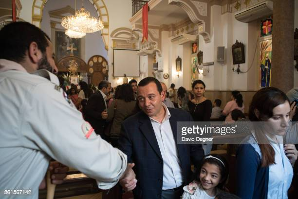 Families exit the old sanctuary of the Holy Family Church during Holy Week on April 13 2017 in Cairo Egypt