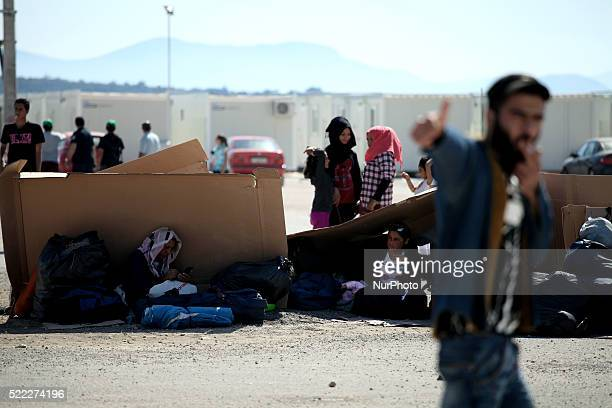Families find shadow under cartons while wait to register Refugee camp in Skaramaga area a port town 11 km west of Athens A large camp is being...