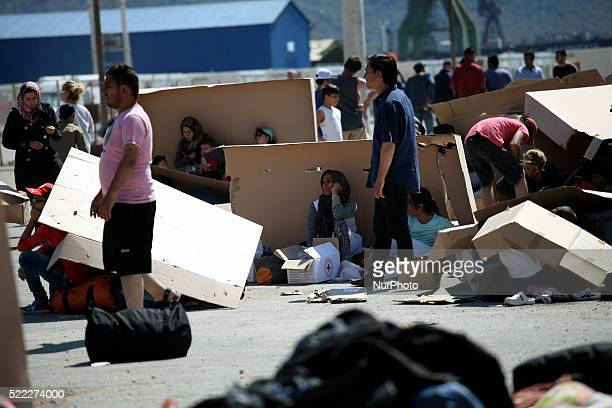 Families find shadow under cartons while waits to register Refugee camp in Skaramaga area a port town 11 km west of Athens A large camp is being...