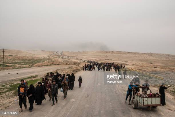 Families flee as Iraqi forces advance into west Mosul part of the offensive to retake the city some two years after it fell to Islamic State on March...