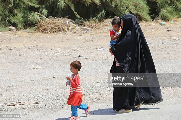 Families fleed from clashes between army groups led by Islamic State of Iraq and the Levant and peshmargas and pass to secure Kurd region by walking...
