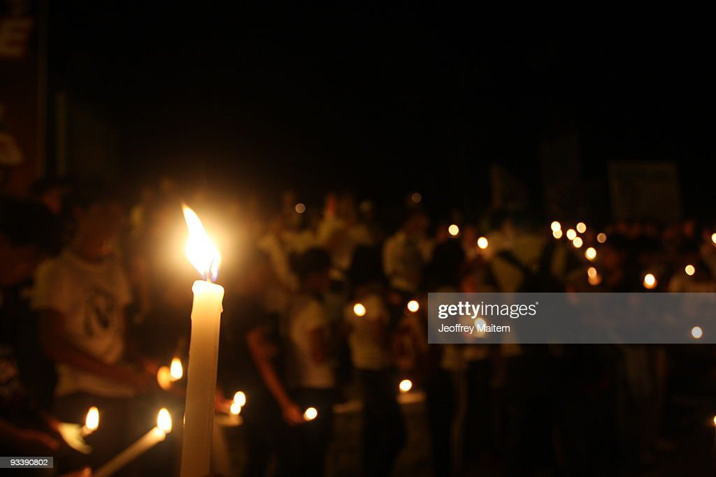 Candles Lit For Victims of Philippine Massacre : News Photo