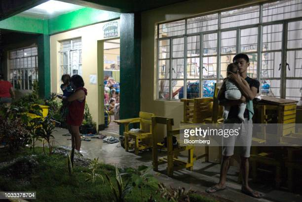 Families gather at a temporary evacuation center at Balzain East Elementary School ahead of Typhoon Mangkhut's arrival in Tuguegarao Cagayan province...