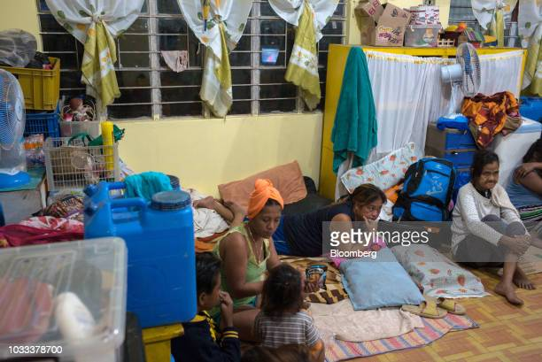 Families gather inside a temporary evacuation center at Balzain East Elementary School ahead of Typhoon Mangkhut's arrival in Tuguegarao Cagayan...