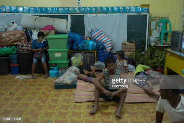 Families gather inside the temporary evacuation center at Balzain East Elementary School ahead of Typhoon Mangkhut's arrival in Tuguegarao Cagayan...