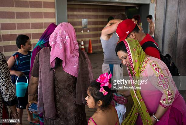 Families gather near the boardwalk July 24 2015 at Coney Island Beach in the Brooklyn borough of New York