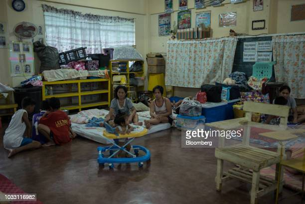 Families gather the temporary evacuation center at Balzain East Elementary School ahead of Typhoon Mangkhut's arrival in Tuguegarao Cagayan province...