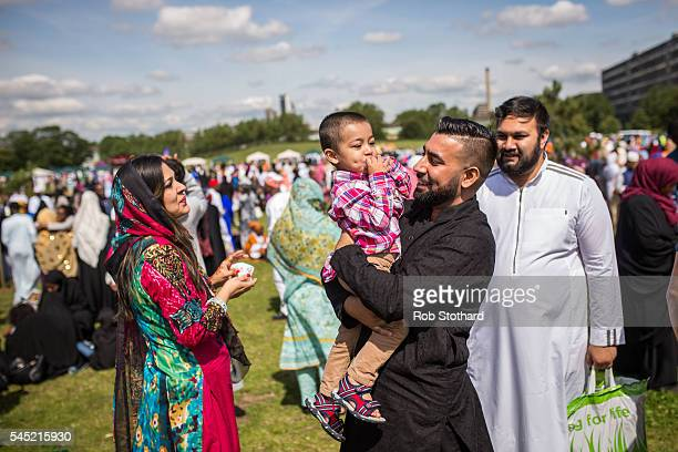 Families gather to celebrate the festival of Eid at Southwark Eid Festival in Burgess Park on July 6 2016 in London England Thousands gathered at...