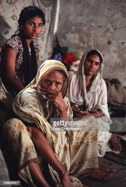 Families huddle in a cyclone shelter waiting for emergency relief after one of the biggest cyclones to hit Bangladesh in recent decades Thousands of...