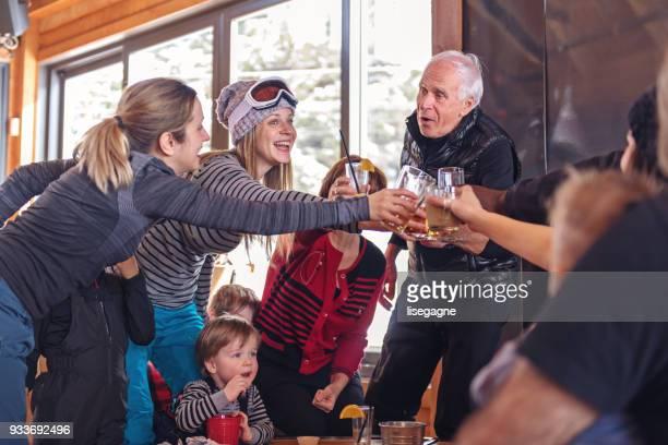 Families in a ski resort, apres-ski relaxing