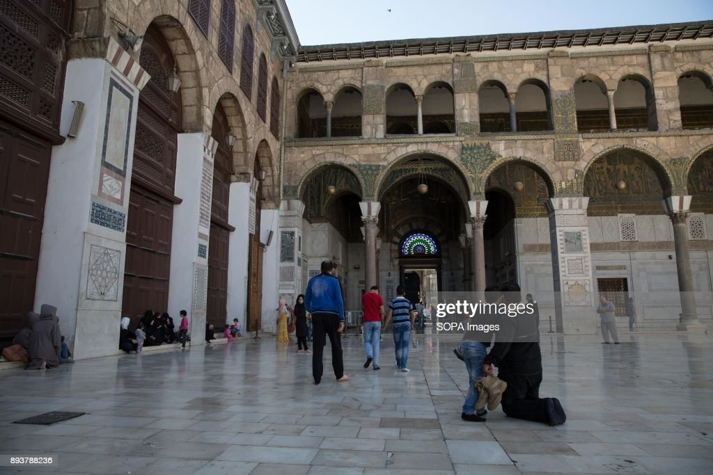 Families leave Damascus' Umayyad Mosque after Friday prayers... : News Photo