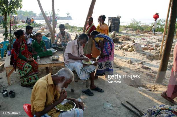 Families losing their homesteads take shelter on the river bank after losing houses in erosion of the River Padma at Goalanda in Rajshahi Bangladesh...