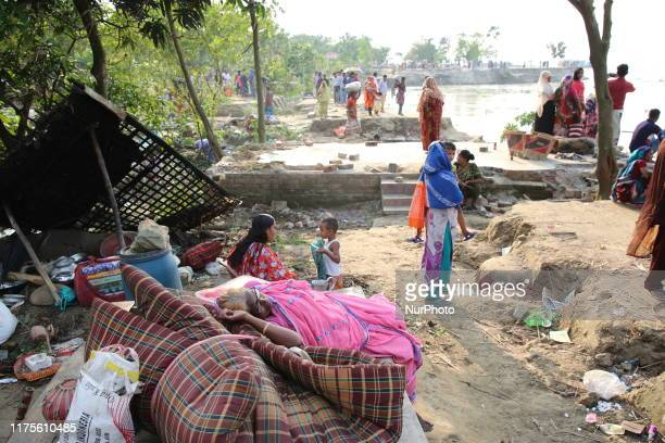 Families losing their homesteads take shelter on the river bank in Rajshahi Bangladesh on 12 October 2019 At least 350 homesteads and 500 hectares of...