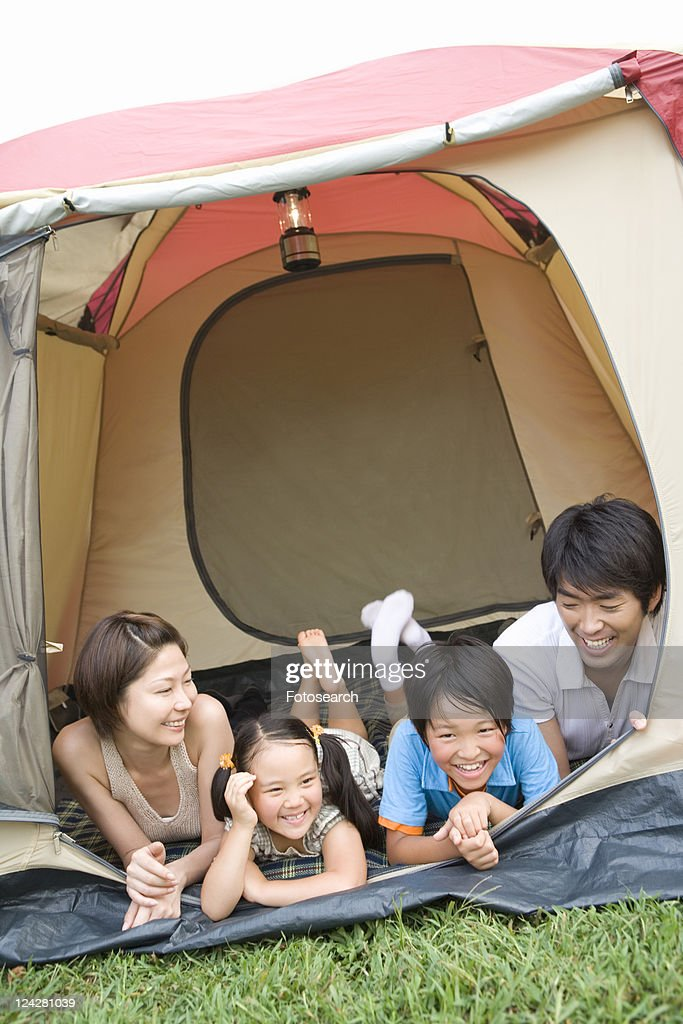 Families Lying in Tent : ストックフォト