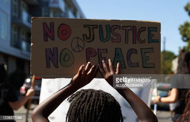 Families march for Black Lives asking for justice and police reform in Portland, Oregon on September 6, 2020. - Aaron Danielson a supporter of a...