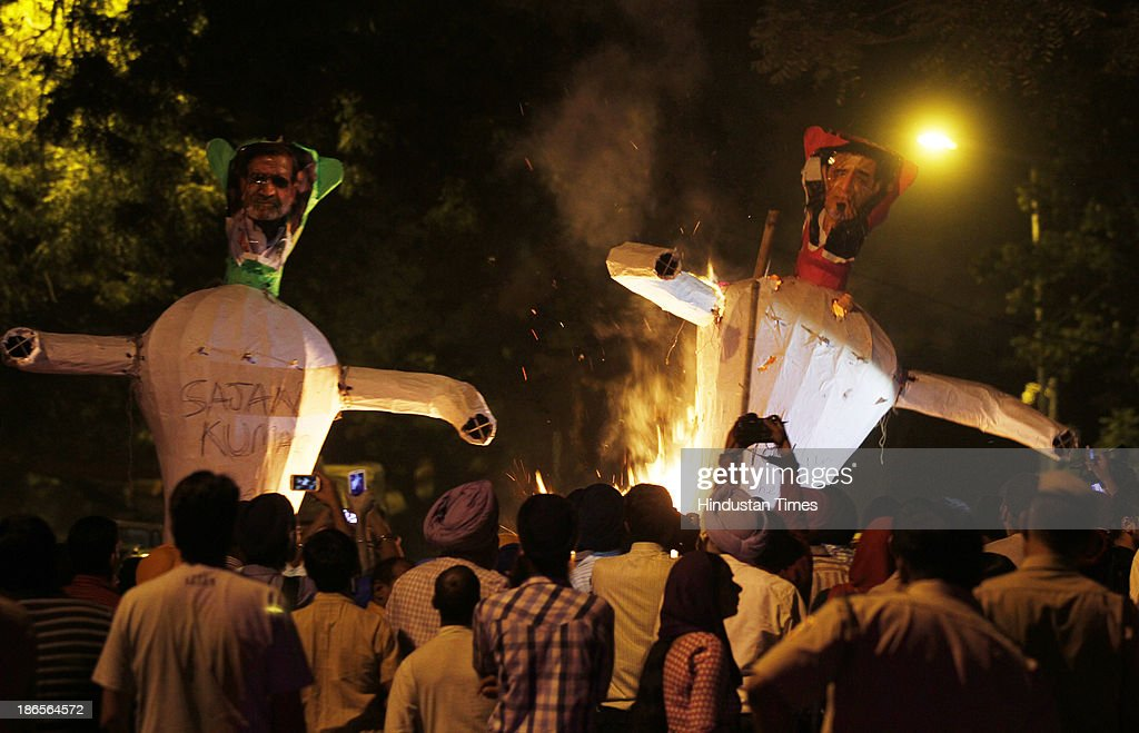 Families of 1984 Anti-Sikh riots victims burn effigy of Congress leader Sajjan Kumar and Jagdish Tytler during the protest demanding justice at Jantar Mantar on November 1, 2013 in New Delhi, India. Thousands of Sikhs were killed in riots in various parts of India in November 1984 in the aftermath of the assassination of then prime minister Indira Gandhi by her two Sikh bodyguards on October 31, 1984.