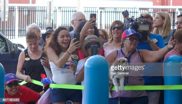 Families of Caribbean hurricane evacuees who arrived on board the Royal Caribbean Adventure of the Seas rush to greet their relatives Tuesday Oct 3...