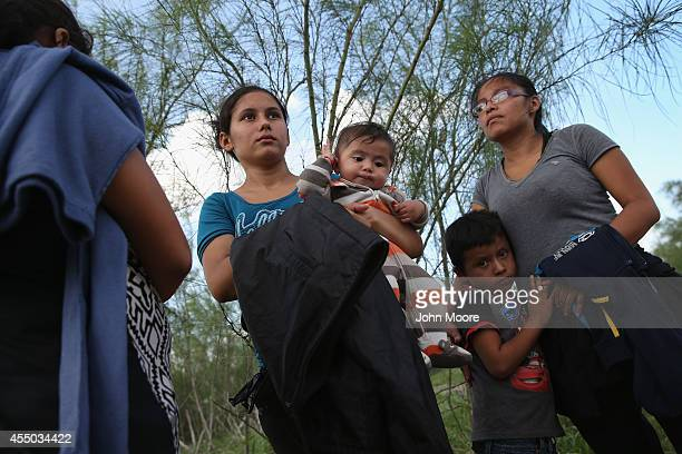 Families of Central American immigrants turn themselves in to US Border Patrol agents after crossing the Rio Grande River from Mexico on September 8...