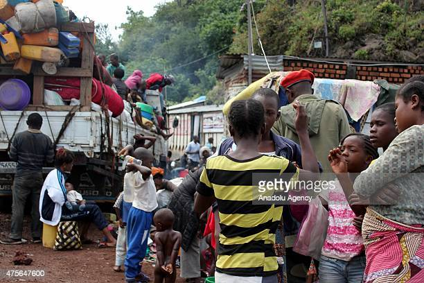 Families of congolese soldiers wait at Goma Harbor in Goma, Congo on June 02, 2015. Congolese soldiers have been sent to Beni to fight against rebels...