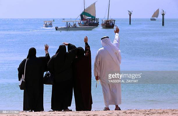 Families of Kuwaiti sailors bid them farewell as they prepare to sail away in Dhows on a pearl diving trip on July 28 in Kuwait City Pearldiving...