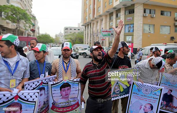 Families of Palestinian prisoners held in Israeli jails stage a protest rally to demand the release of prisoners outside the International Committee...