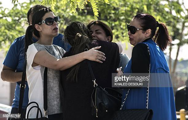 TOPSHOT Families of passengers who were flying in an EgyptAir plane that vanished from radar en route from Paris to Cairo react as they wait outside...