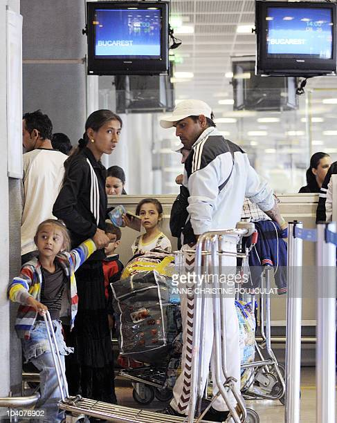 Families of Roma community arrive with their luggages at the Marseille Provence airport in Marignane On September 14, 2010 prior to taking a flight...