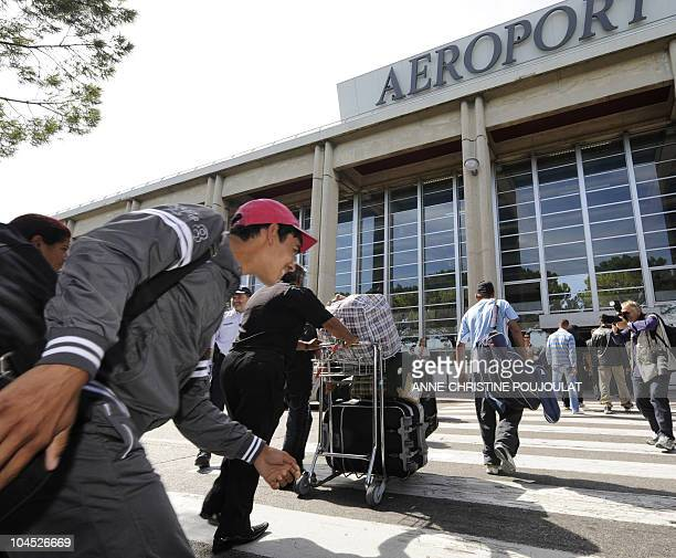 Families of Roma community arrive with their luggages at the Marseille Provence airport in Marignane On September 14 2010 prior to taking a flight to...