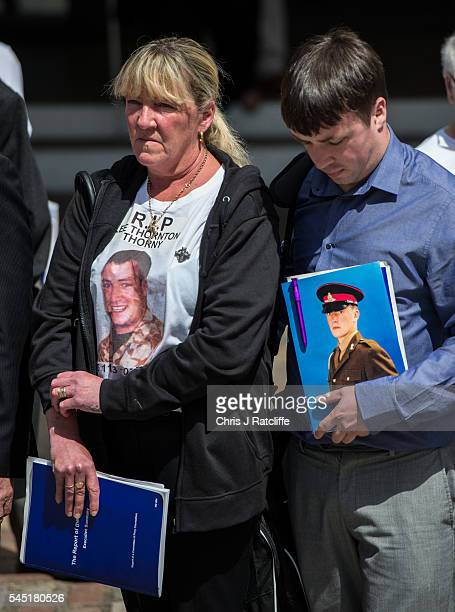 Families of soldiers killed in the Iraq conflict stand together outside the Queen Elizabeth II conference centre after the outcome of the Chilcot...
