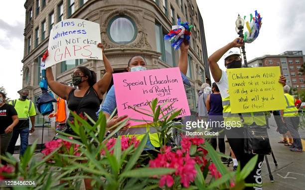 Families of special-needs students, supporters, and the students themselves protest outside Boston Public Schools' headquarters in Boston's Roxbury...
