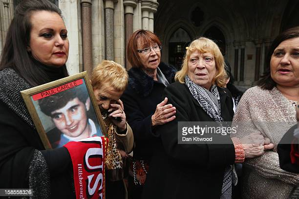 Families of the 96 football fans who lost their lives during the Hillsborough disaster gather outside the High Court on December 19 2012 in London...