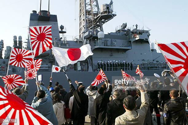 """Families of the Japanese Self Defence Force see off the Japanese support vessel """"Murasame"""" sailing to Muroran, Japan, on a mission to protect the..."""