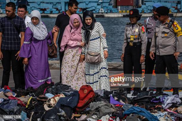 Families of the victims of Lion Air flight JT 610 visit an operations centre to look for personal items of their relatives at the Tanjung Priok port...