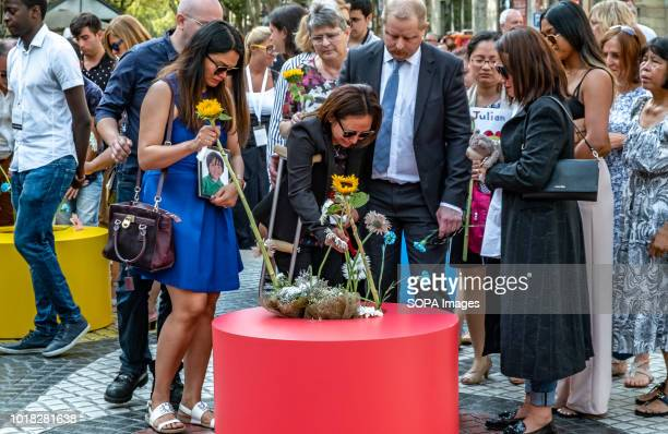 Families of the victims of the Ramblas are seen depositing bouquets of flowers Barcelona celebrated the first anniversary of the terrorist attack on...