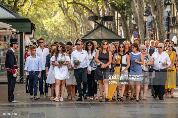 Families of the victims of the Ramblas are seen with bouquets of flowers Barcelona celebrated the first anniversary of the terrorist attack on the...