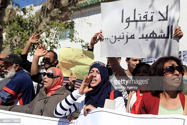 Families of Tunisian revolution martyrs and wounded people stage a protest against the Tunisian court decision outside the Tunisian constituent...