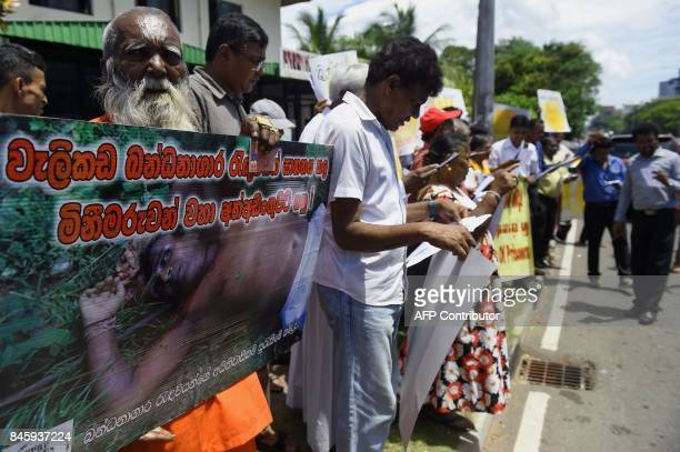Families of victims and rights activists demonstrate outside Sri Lanka's main prison demanding justice for the 27 inmates shot dead by security...