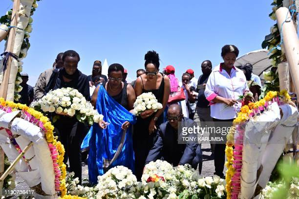 Families of victims from Kenya and Rwanda lay flowers on March 15 as they visit the crash site of the Ethiopian Airlines operated Boeing 737 MAX...