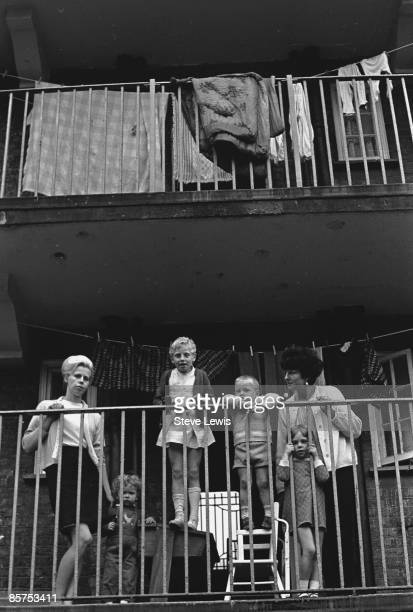 Families on a balcony of a council block in the East End of London 1960s