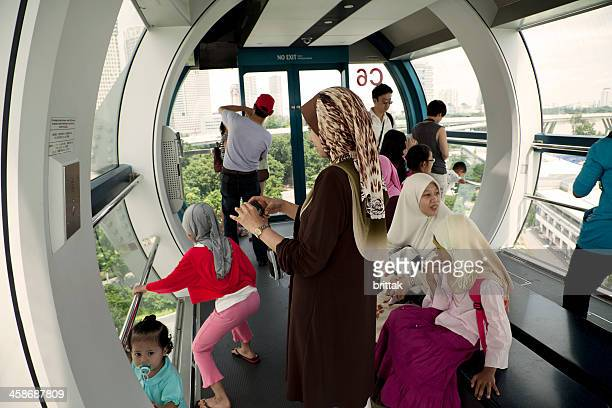 families on board singapore flyer- - singapore flyer stock photos and pictures