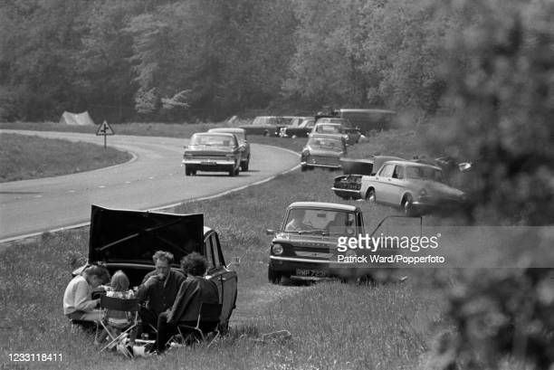 Families picnicking beside a busy roadway enroute to Woburn Abbey and Gardens in Bedfordshire, circa July 1969. From a series of images to illustrate...