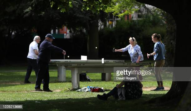Families play table tennis in Abington Park on May 16, 2020 in Northampton, United Kingdom. The prime minister announced the general contours of a...