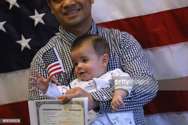 Families pose for photos following a naturalization ceremony on January 22 2018 in Newark New Jersey Immigrants from 32 different countries became...