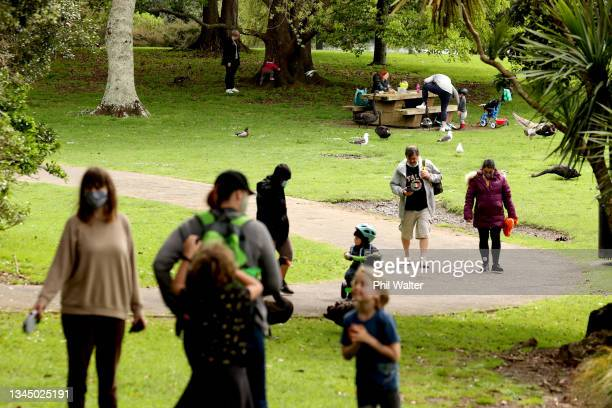 Families re-unite with a picnic at Western Springs on October 06, 2021 in Auckland, New Zealand. Alert Level 3 restrictions have eased slightly...